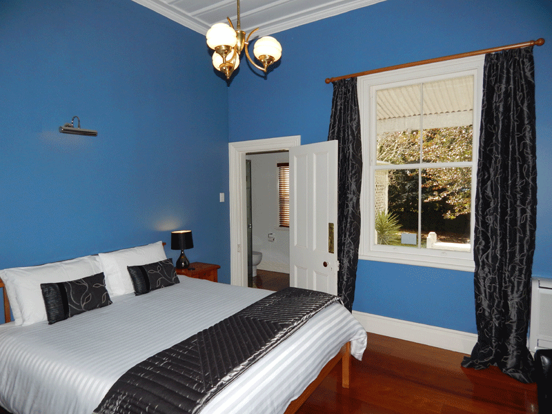 King-size bed in the bedroom of the Blue Room Suite
