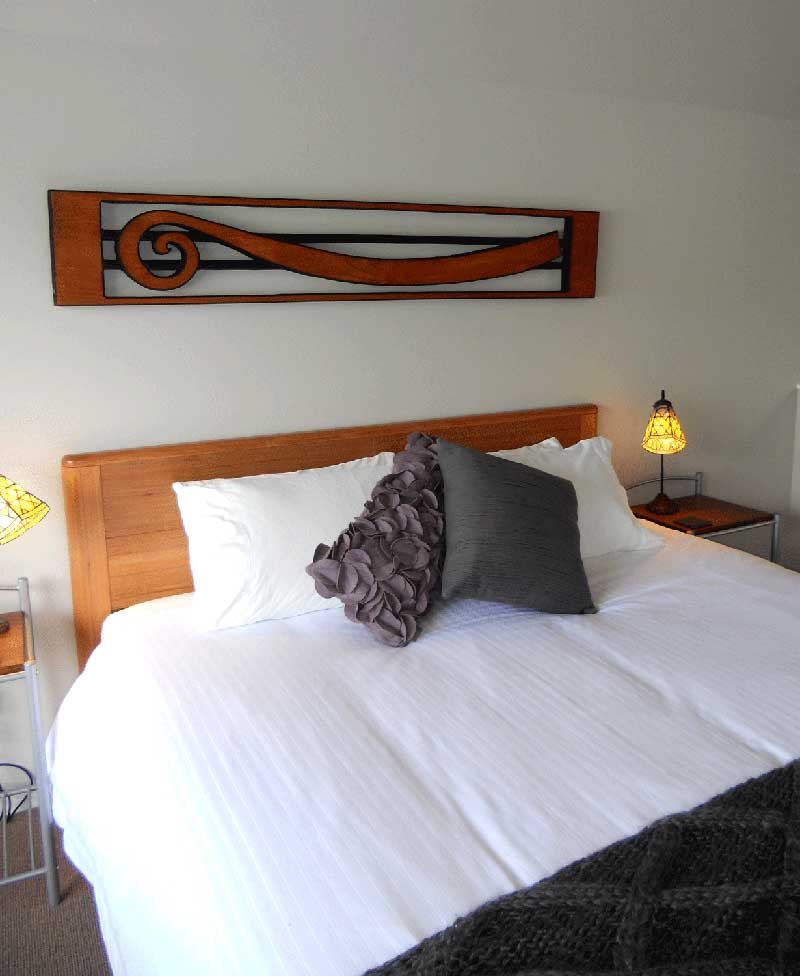 King bed in the upstairs bedroom