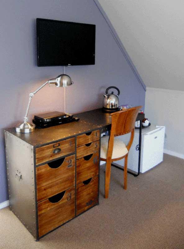 "32""TV, desk, DVD player, tea/coffee facilities, fridge upstairs"